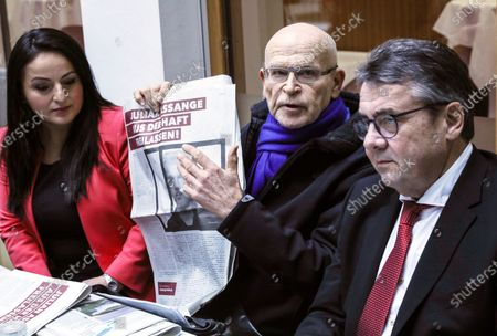 Stock Photo of German journalist Guenter Wallraff (C) shows a paper clipping next to the former leader of the Social Democratic Party (SPD), Sigmar Gabriel (R), and the member of the Left Party in Bundestag, Sevim Dagdelen (L), ahead of a press conference calling for the release of activist Julian Assange, in Berlin, Germany, 06 February 2020. Politicians of various parties have started an initiative to demand the release of the Wikileaks founder from his extradition custody in the United Kingdom. The hearing about his delivery to the United States will take place this month.
