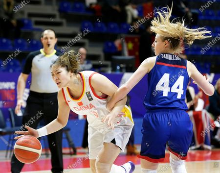 China's Meng Li (L) in action against Britain's Karlie Samuelson (R) during the Women's Olympic Qualifying Tournament basketball game between China and Britain in Belgrade, Serbia, 06 February 2020.