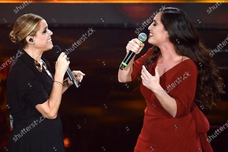 Stock Photo of Italian singer Tosca (L) with Spanish singer Silvia Perez Cruz (R) perform on stage at the Ariston theatre during the 70th Sanremo Italian Song Festival in Sanremo, Italy, 06 February 2020. The festival runs from 04 to 08 February.