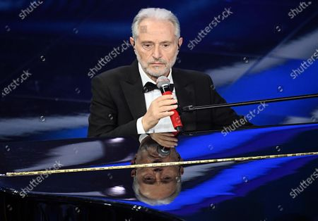 Stock Picture of Amedeo Minghi performs on stage at the Ariston theatre during the 70th Sanremo Italian Song Festival in Sanremo, Italy, 06 February 2020. The festival runs from 04 to 08 February.
