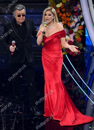 Stock Picture of Albanian TV host, singer and producer Alketa Vejsiu (R) and Italian singer Bobby Solo (L) perform on stage at the Ariston theatre during the 70th Sanremo Italian Song Festival in Sanremo, Italy, 06 February 2020. The festival runs from 04 to 08 February.