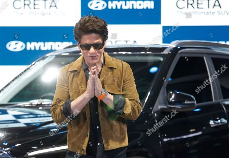 Bollywood actor and brand ambassador of Hyundai Shah Rukh Khan greets the media during the launch of the all new Creta car at the Auto Expo, in Greater Noida, near New Delhi, India