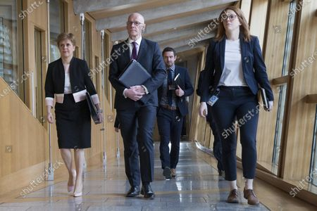 Scottish Parliament First Minister's Questions - Nicola Sturgeon, First Minister of Scotland and Leader of the Scottish National Party (SNP), and John Swinney, Deputy First Minister and Cabinet Secretary for Education and Skills, make their way to the Debating Chamber.