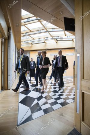 Scottish Parliament First Minister's Questions - Fergus Mutch, SNP Head of Communications and Research, Nicola Sturgeon, First Minister of Scotland and Leader of the Scottish National Party (SNP), and John Swinney, Deputy First Minister and Cabinet Secretary for Education and Skills, leave the Debating Chamber after FMQs.
