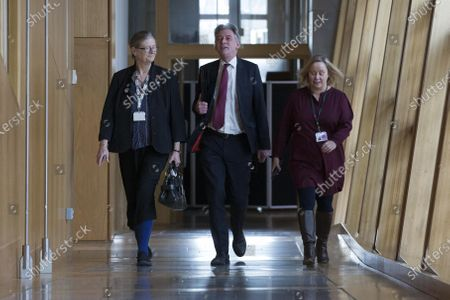 Scottish Parliament First Minister's Questions - Claudia Beamish, Richard Leonard, Leader of the Scottish Labour Party, and Lynn McMath, Director of Communications at the Scottish Labour Party, make their way to the Debating Chamber.