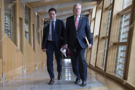 Scottish Parliament First Minister's Questions - Maurice Golden and Jackson Carlaw, Interim Leader of the Scottish Conservative and Unionist Party, make their way to the Debating Chamber.