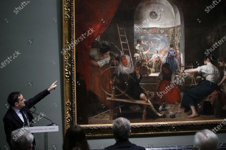 Javier Portus (L), the head of Conservation of Spanish Painting at the Prado Museum, speaks about the artwork 'Las Hilanderas' (The Spinners) by Spanish painter Diego Velazquez, during the launch of a new  museum installation project focused on the Velazquez' masterpiece at the Prado Museum in Madrid, Spain, 06 February 2020. The project is organized with the collaboration of American Friends of the Prado Museum.