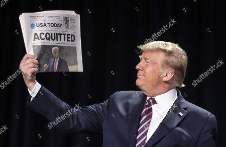 US President Donald Trump holds a copy of the USA Today newspaper fronting with his Impeachment acquittal, as he arrives to the 68th Annual National Prayer Breakfast in Washington, DC, USA, 06 February 2020. The Senate on 05 February 2020 acquitted US President Trump in the impeachment trial on the charges of abuse of power and obstruction of Congress.