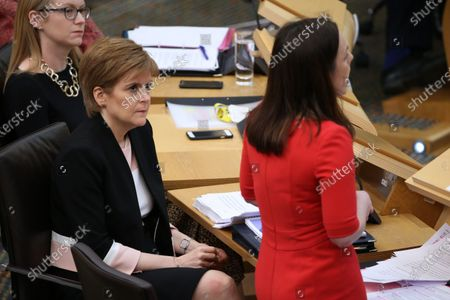 Scottish Budget 2020-21 - Shirley-Anne Somerville, Cabinet Secretary for Social Security and Older People, and Nicola Sturgeon, First Minister of Scotland and Leader of the Scottish National Party (SNP), listen to Kate Forbes, Minister for Public Finance and Digital Economy, delivering the ministerial statement on the Scottish Budget after Derek Mackay resigned as Cabinet Secretary for Finance, Economy and Fair Work.