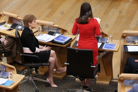 Scottish Budget 2020-21 - Nicola Sturgeon, First Minister of Scotland and Leader of the Scottish National Party (SNP), listen to Kate Forbes, Minister for Public Finance and Digital Economy, delivering the ministerial statement on the Scottish Budget after Derek Mackay resigned as Cabinet Secretary for Finance, Economy and Fair Work.