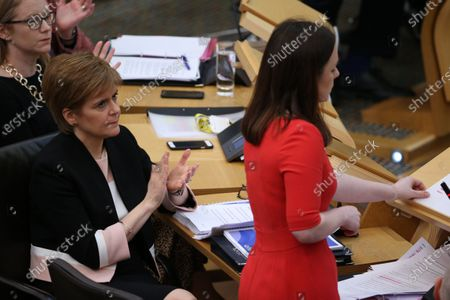 Scottish Budget 2020-21 - Shirley-Anne Somerville, Cabinet Secretary for Social Security and Older People, and Nicola Sturgeon, First Minister of Scotland and Leader of the Scottish National Party (SNP), applaud Kate Forbes, Minister for Public Finance and Digital Economy, during her delivery of the ministerial statement on the Scottish Budget after Derek Mackay resigned as Cabinet Secretary for Finance, Economy and Fair Work.