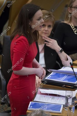 Scottish Budget 2020-21 - Nicola Sturgeon, First Minister of Scotland and Leader of the Scottish National Party (SNP), listens to Kate Forbes, Minister for Public Finance and Digital Economy, delivering the ministerial statement on the Scottish Budget after Derek Mackay resigned as Cabinet Secretary for Finance, Economy and Fair Work.