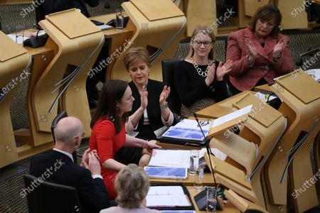 Scottish Budget 2020-21 - John Swinney, Deputy First Minister and Cabinet Secretary for Education and Skills, Nicola Sturgeon, First Minister of Scotland and Leader of the Scottish National Party (SNP), Shirley-Anne Somerville, Cabinet Secretary for Social Security and Older People, and Fiona Hyslop, Cabinet Secretary for Culture, Tourism and External Affairs, applaud Kate Forbes, Minister for Public Finance and Digital Economy, after her delivery of the ministerial statement on the Scottish Budget after Derek Mackay resigned as Cabinet Secretary for Finance, Economy and Fair Work.