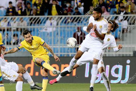 Al-Nassr's Petros (L) in action against Al-Fateh's Ali Al Hassan (C) and Al-Fateh's Gustav Wikheim (R) during the Saudi Professional League soccer match between Al-Nassr and Al-Fateh at Prince Faisal bin Fahd Stadium, Riyadh, Saudi Arabia, 06 February 2020.