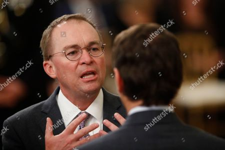White House acting chief of staff Mick Mulvaney mingles with other attendees in the in the East Room of the the White House in Washington, before President Donald Trump arrives to speak