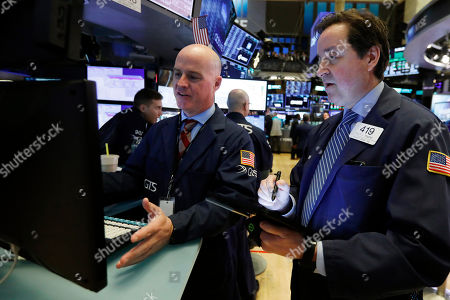 John O'Hara, Philip Powers. Specialist John O'Hara, left, and trader Philip Powers work on the floor of the New York Stock Exchange,. U.S. stocks rose in midday trading Thursday as investors continued focusing on the latest round of corporate earnings and China cut tariffs on key imports as part of a trade war truce