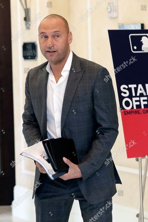 Derek Jeter, CEO and part owner of the Miami Marlins, leaves a meeting during MLB baseball owners meetings, in Orlando, Fla