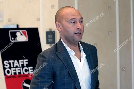 Derek Jeter CEO and part owner of the Miami Marlins leaves a meeting during MLB baseball owners meetings, in Orlando, Fla