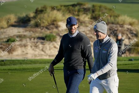 Tony Romo, Jim Furyk. Tony Romo, left, talks with Jim Furyk while walking up to the second green of the Spyglass Hill Golf Course during the first round of the AT&T Pebble Beach National Pro-Am golf tournament, in Pebble Beach, Calif