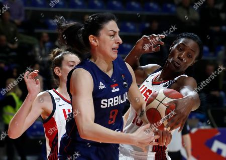 Serbia's Jelena Brooks, center, tries to score as United States' Breanna Stewart, left, and United States' Sylvia Fowles block her during the Women's Olympic Qualifying Tournaments match between USA and Serbia in Belgrade, Serbia