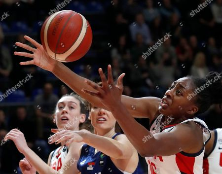 United States' Nneka Ogwumike, right, tries to score as Serbia's Tina Jovanovic blocks her during the Women's Olympic Qualifying Tournaments match between USA and Serbia in Belgrade, Serbia