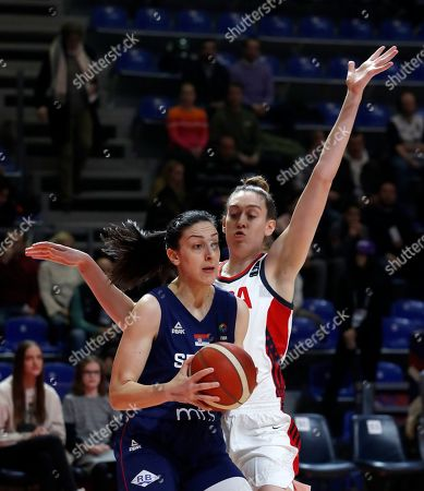 Serbia's Jelena Brooks, left, drives to the basket as United States' Breanna Stewart tries to block her during the Women's Olympic Qualifying Tournaments match between USA and Serbia in Belgrade, Serbia