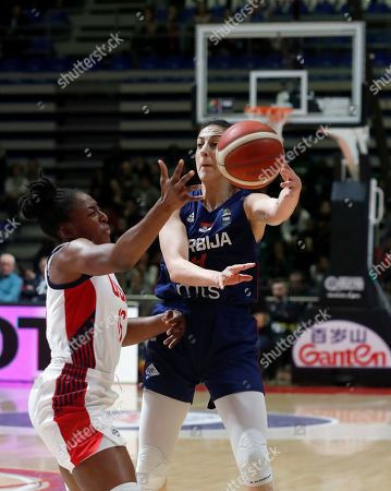 Serbia's Jelena Brooks, right, tries to score as United States' Nneka Ogwumike blocks her during the Women's Olympic Qualifying Tournaments match between USA and Serbia in Belgrade, Serbia
