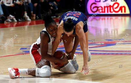United States' Nneka Ogwumike, left, fights for the ball with Serbia's Ana Dabovic during the Women's Olympic Qualifying Tournaments match between USA and Serbia in Belgrade, Serbia