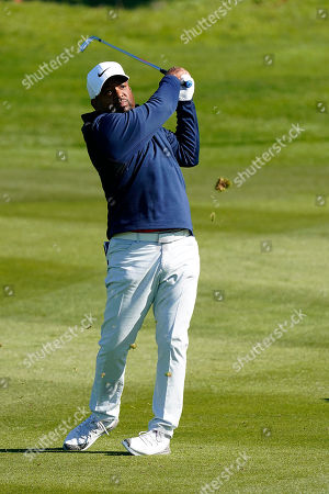 Alfonso Ribeiro hits from the second fairway of the Spyglass Hill Golf Course during the first round of the AT&T Pebble Beach National Pro-Am golf tournament, in Pebble Beach, Calif