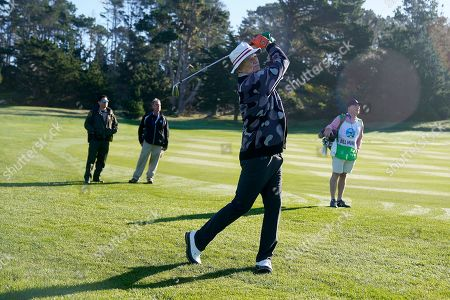 Aaron Rogers putts on the second green of the Spyglass Hill Golf Course during the first round of the AT&T Pebble Beach National Pro-Am golf tournament, in Pebble Beach, Calif