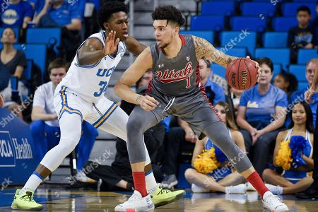 David Singleton, Timmy Allen. Utah forward Timmy Allen, right, posts up on UCLA guard David Singleton during the first half of an NCAA college basketball game in Los Angeles