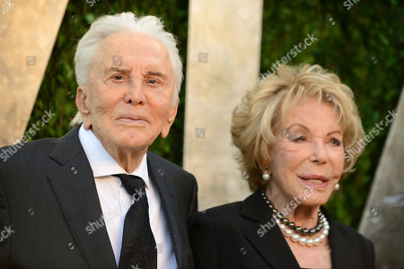 """Kirk Douglas, Anne Buydens. Kirk Douglas, left, and his wife Anne Buydens at the 2013 Vanity Fair Oscars Party in West Hollywood, Calif. Douglas, the intense, muscular actor with the dimpled chin who starred in """"Spartacus,"""" """"Lust for Life"""" and dozens of other films, died, at age 103"""