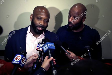 Entrepreneurs Kevin Hart, of Randolph, Mass., left, and Kobie Evans, of Boston, right, speak to reporters after attending a meeting of the Massachusetts Cannabis Control Commission, in Worcester, Mass. The commission voted in favor final approval of licenses for a number of cannabis shops, including Pure Oasis, a soon to open pot shop in Boston's Dorchester neighborhood by Evans and Hart