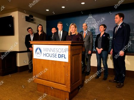 Minnesota House Democratic leaders line up for a news conference, at the state Capitol in St. Paul, Minnesota. Pictured left to right are Rep. Michael Howard, of Richfield; House Majority Whip Liz Olson, of Duluth; Assistant Majority Leader Fue Lee, of Minneapolis; Majority Leader Ryan Winkler, of Golden Valley; Speaker Melissa Hortman, of Brooklyn Park; Rep. David Pinto, of St. Paul; Rep. Carlie Kotyza-Witthuhn, of Eden Prairie; and Assistant Majority Leader Jamie Long, of Minneapolis