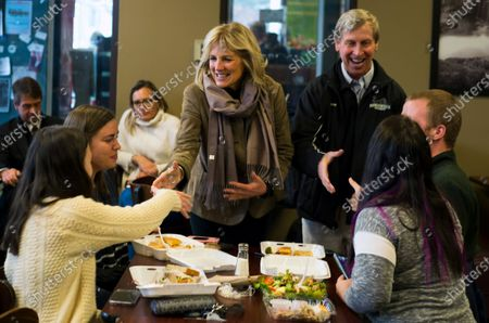 Jill Biden (5L), wife of Democratic candidate for United States President, Former Vice President Joe Biden, along with former New Hampshire Governor John Lynch (3R) meet with voters at the Bridge Cafe in Manchester, New Hampshire, USA 06 February 2020. The first in the Nation primary is to be held in New Hampshire on 11 February 2020.