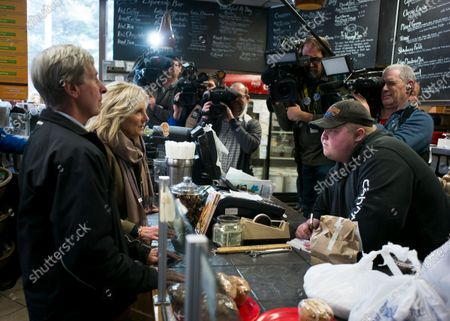 Jill Biden (2L), wife of Democratic candidate for United States President, Former Vice President Joe Biden, along with former New Hampshire Governor John Lynch (L) order food before meeting with voters at the Bridge Cafe in Manchester, New Hampshire, USA 06 February 2020. The first in the Nation primary is to be held in New Hampshire on 11 February 2020.