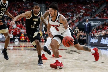 Louisville guard Lamarr Kimble (0) drives against Wake Forest guard Torry Johnson (11) during the second half of an NCAA college basketball game, in Louisville, Ky. Louisville won 86-76