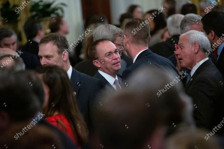 Acting White House Chief of Staff Mick Mulvaney is seen in the East Room after US President Donald Trump delivered remarks regarding the Senate vote to acquit him of both articles of impeachment at the White House in Washington DC
