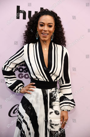 Political commentator Angela Rye poses at the 13th Annual ESSENCE Black Women in Hollywood Awards Luncheon, in Beverly Hills, Calif