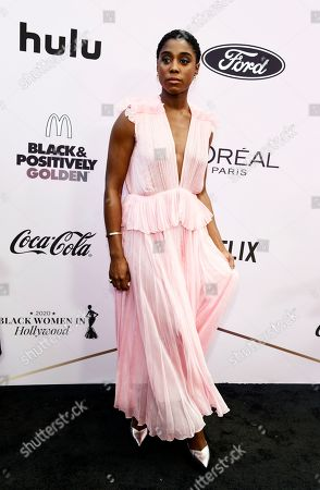 Lashana Lynch poses at the 13th Annual ESSENCE Black Women in Hollywood Awards Luncheon, in Beverly Hills, Calif