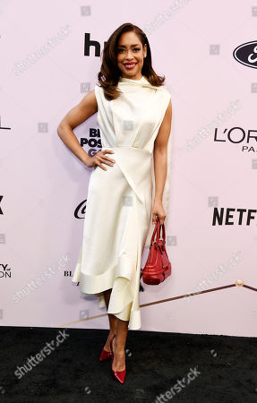 Gina Torres poses at the 13th Annual ESSENCE Black Women in Hollywood Awards Luncheon, in Beverly Hills, Calif