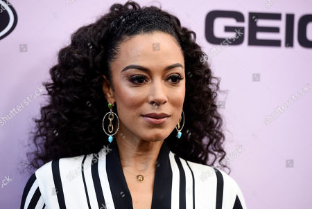 Stock Image of Political commentator Angela Rye poses at the 13th Annual ESSENCE Black Women in Hollywood Awards Luncheon, in Beverly Hills, Calif