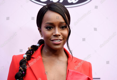 Aja Naomi King poses at the 13th Annual ESSENCE Black Women in Hollywood Awards Luncheon, in Beverly Hills, Calif