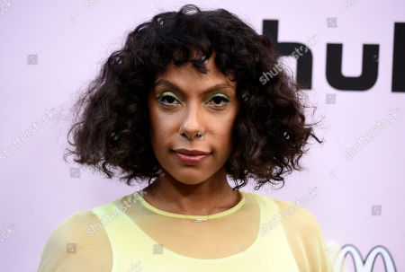 Melina Matsoukas poses at the 13th Annual ESSENCE Black Women in Hollywood Awards Luncheon, in Beverly Hills, Calif