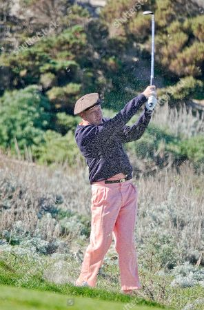 Macklemore plays a shot from the rough at Spyglass Hill