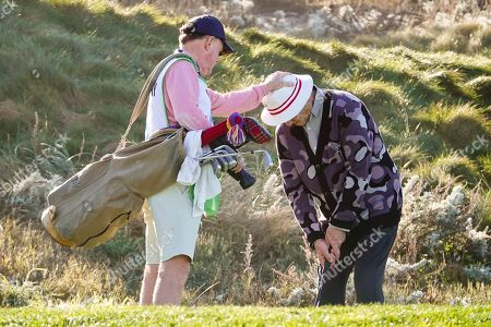 "Bill Murray on the 3rd tee gets some ""head support"" from his longtime caddy at Spyglass Hill fairway"