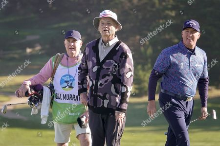 Bill Murray watches his putt on the 2nd alongside his longtime pro-partner D. A. Points at Spyglass Hill fairway