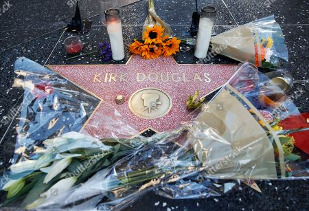 """Flowers adorn actor Kirk Douglas' star on the Hollywood Walk of Fame, in Los Angeles. Douglas, the muscular actor with the dimpled chin who starred in """"Spartacus,"""" """"Lust for Life"""" and dozens of other films and helped fatally weaken the Hollywood blacklist, died at 103, on Wednesday"""