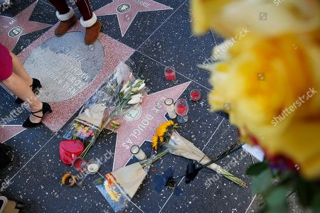 """People stand around actor Kirk Douglas' star on the Hollywood Walk of Fame, in Los Angeles. Douglas, the muscular actor with the dimpled chin who starred in """"Spartacus,"""" """"Lust for Life"""" and dozens of other films and helped fatally weaken the Hollywood blacklist, died at 103, on Wednesday"""