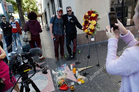 """People take pictures at actor Kirk Douglas' star on the Hollywood Walk of Fame, in Los Angeles. Douglas, the muscular actor with the dimpled chin who starred in """"Spartacus,"""" """"Lust for Life"""" and dozens of other films and helped fatally weaken the Hollywood blacklist, died at 103, on Wednesday"""